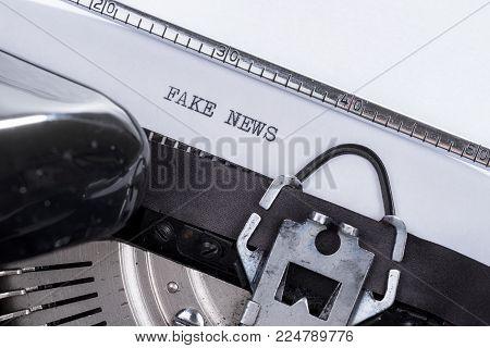 Black text Fake News written on an old retro typewriter