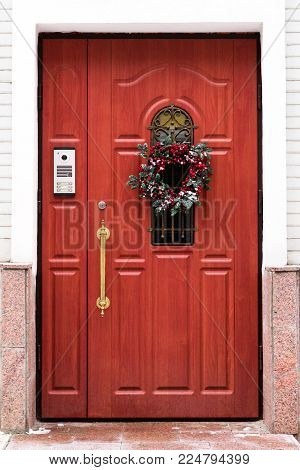 Door with a Christmas wreath. Security entry control.