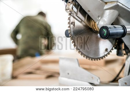 Close-up image of metal circular saw for wood in woodworking shop