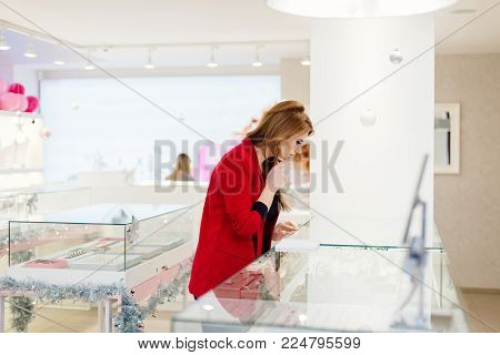 Young Beauty Elegance Woman Trying Ring