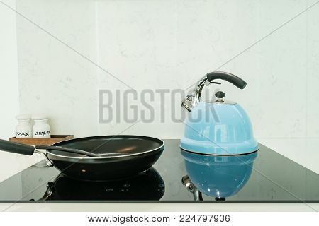 Frying Pan And Pot On Modern Black Induction Stove, Cooker, Hob Or Built In Cooktop With Ceramic Top