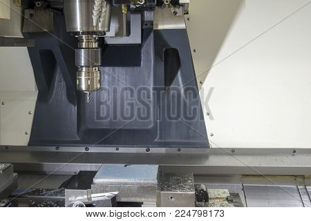 The CNC milling machine cutting the sample part.The special holder attach on the spindle of CNC machine.