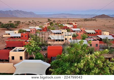 Sossusvlei, Namibia - Jan 30, 2016:  Accommodation units in the Sossusvlei Lodge. View from above at sunset. The most popular place in Namib-Naukluft park.