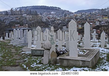 Sarajevo, Bosnia and Herzegovina - December 18, 2017: The cemetery on the hill for people died in Bosnian War in Sarajevo, Bosnia and Herzegovina