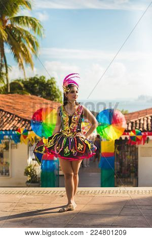 Brazilian Carnival. Woman wearing carnival costumes and dancing in the city of Olinda, Pernambuco, Brazil.