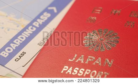 Japanese citizen passport and a flight ticket for a travel