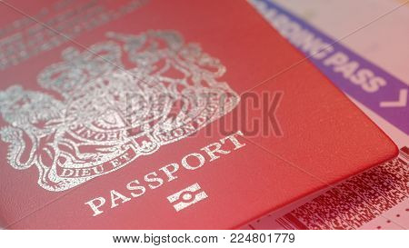 Great Britain citizen passport and a flight ticket for a travel