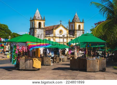 OLINDA, BRAZIL, JANUARY 29 - 2018 - São Salvador do Mundo church is located in front of craft fair in the Olinda town, Pernambuco, Brazil.