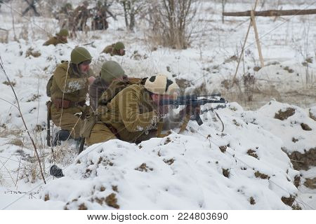 SAINT PETERSBURG, RUSSIA - JANUARY 14, 2018: Soviet infantrymen of the Second World War in battle. Fragment of the historical reconstruction of the military operation