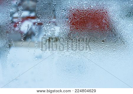Close up detail of moisture condensation problem, hot water vapor condensed on the cold window glass, macro