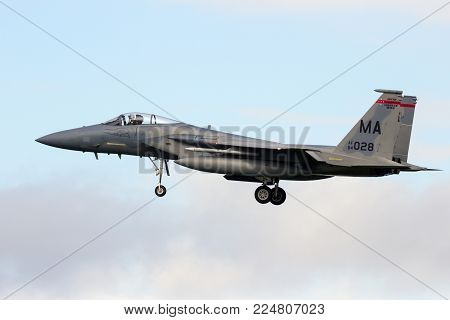 LEEUWARDEN, NETHERLANDS - APR 7, 2016: US Air Force F-15 Eagle fighter jet plane landing.