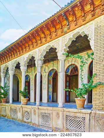 Shiraz, Iran - October 12, 2017: The  Scenic Arched Galley Of Zinat Ol-molk Mansion With Rich Patter