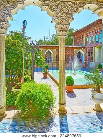 Shiraz, Iran - October 12, 2017: The View On Fountain And Garden Of Zinat Ol-molk Complex From Its C