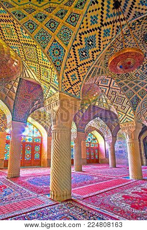 Shiraz, Iran - October 12, 2017: The Walk Among The Carved Stone Columns Of The Pink Mosque (nasir O