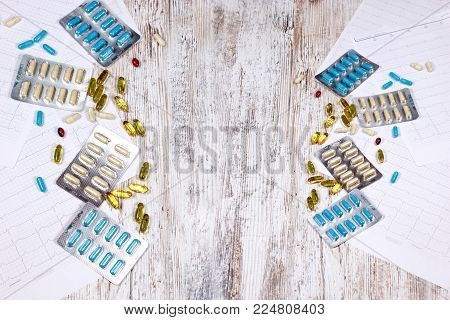 Pharmaceutical industry - medications tablets and capsules on table close-up