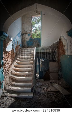 Abandoned and dilapidated stairway with exposed brick on Lesvos, Greece