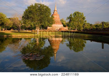 A sunny evening in the historic park of Sukhothai. Thailand