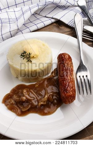 irish banger and mash with thyme on a plate, a traditional dish of the british isles