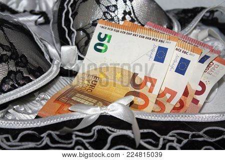 Lover or luxury prostitute concept photo with euro banknotes and lacy lingerie