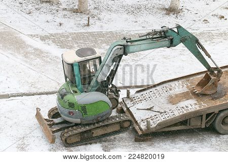 small excavator on the transport platform of the car