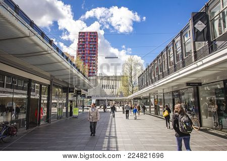 APRIL 2015, ROTTERDAM NETHERLANDS: Modern buildings of Rotterdam, big red contemporary statues