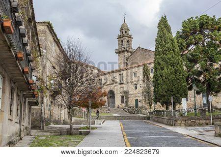 SANTIAGO DE COMPOSTELA,SPAIN-NOVEMBER 23,2017:Street view, costa san domingos at background, museum.Santiago de Compostela,Spain.