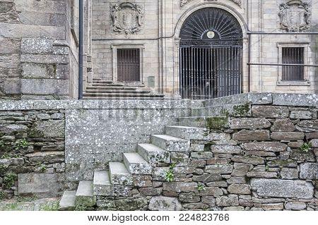 SANTIAGO DE COMPOSTELA,SPAIN-NOVEMBER 23,2017:Ancient building, stone stairs and iron gate entrance church San Domingos de Bonaval.Santiago de Compostela,Spain.