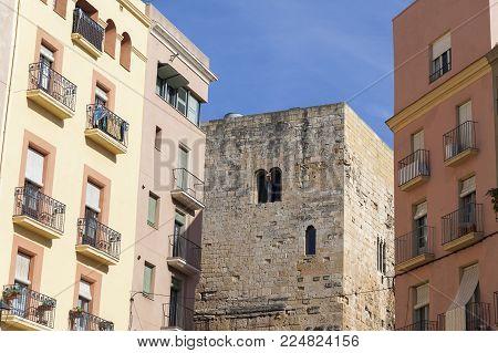 TARRAGONA,SPAIN-MARCH 9,2017:Facade building,roman tower provincial forum of Tarraco between modern buildings.Tarragona,Spain.