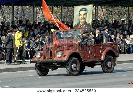 Tyumen, Russia - May 9. 2006: Parade of Victory Day in Tyumen. Members of KPRF with Stalin portrait on SUV of WW2 times on parade
