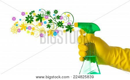 Spring cleaning concept. Floral detergent sprayed by a hand with yellow glove.