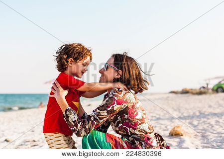 Child With Mom On The Beach.