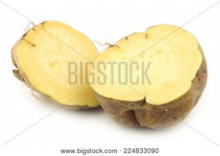 one fresh cut turnip(Brassica rapa rapa) on a white background