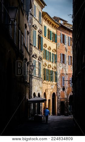 Mysterious alleyway in Siena, Tuscany, Italy - an UNESCO World Heritage Site location