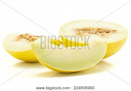Three yellow honeydew melon slices isolated on white background
