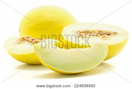 Yellow honeydew melon set isolated on white background one whole, half with seeds, seedless slice