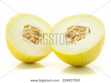 Yellow honeydew melon halves with seeds isolated on white background one cut in half