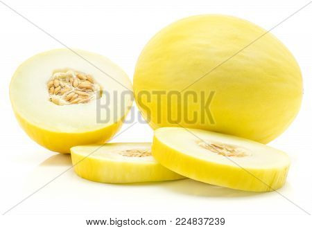 Yellow honeydew melon and one half with two ring slices isolated on white background
