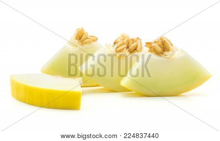 Yellow honeydew melon four cut pieces isolated on white background