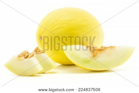 One yellow honeydew melon with one slice and two pieces isolated on white background