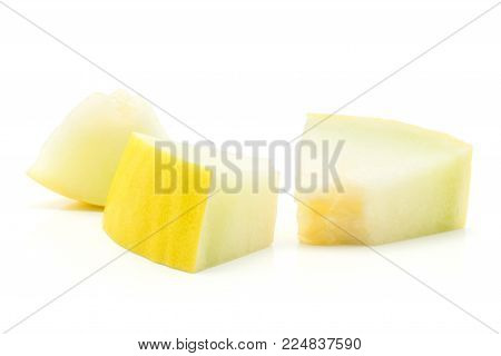 Yellow honeydew melon three sliced pieces isolated on white background