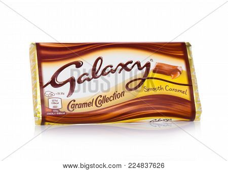 LONDON, UK - FEBRUARY 02, 2018: An unopened Galaxy chocolate bar with smooth caramel on white background.Manufactured by Mars