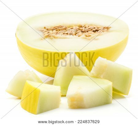 Yellow honeydew melon one half and five sliced pieces isolated on white background