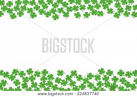 St Patricks Day background - double side borders of green quatrefoils isolated on white background, free space for St Patricks day text. St Patricks day festive background