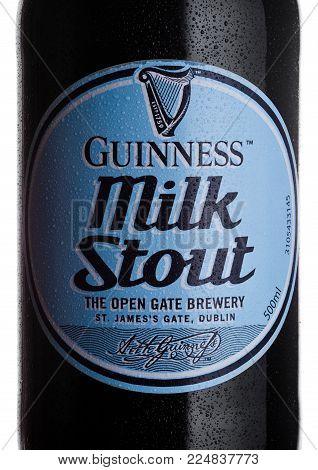 LONDON, UK - FEBRUARY 02, 2018: Bottle lable of Guinness Milk Stout dark beer on white background.