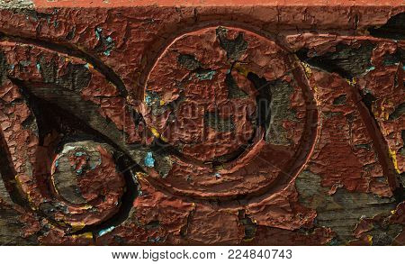 old wooden background with a pattern, worn, painted with paint very old, woodcarving, medieval, texture, background, ancient, red