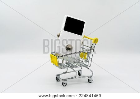 White guitar pedal and yellow shopping cart isolated on white background