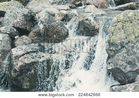 Mountain Brook Waterfall with Grey Rocks Closeup