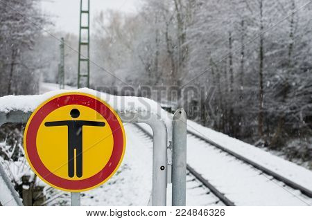 No Trespasing Sign On A Railway Platform During Winter.