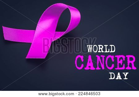 Purple ribbon awareness on black background  for World Cancer day.