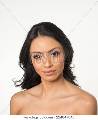 Beautiful woman's face, neck and shoulders